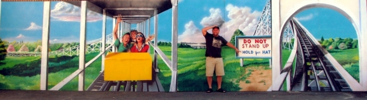 Roller Coaster Scene: This scene depicts a group of screaming people on the roller coaster. It measures 8' tall and is 56' wide on foamcore. It connects to the Hot Air Balloon Scene and The Carousel Scene to form one continuous 140 foot wide piece.