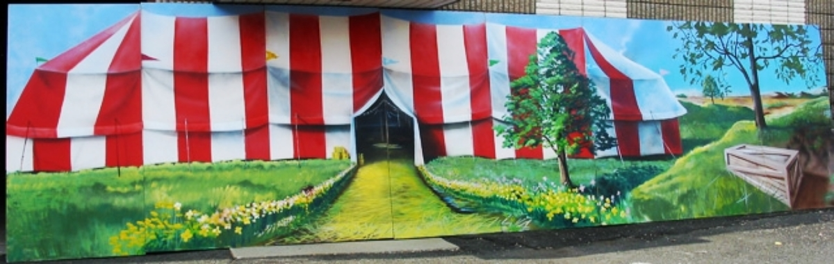 Circus Tent Scene: A beautiful scene with the outside of red and white striped tent. Measures 8' tall and 32' wide, foamcore.