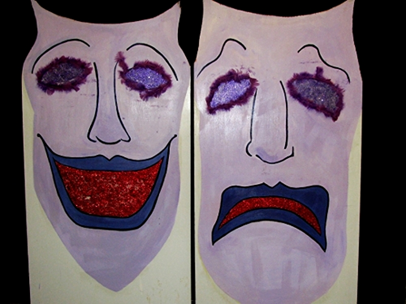 """Comedy and Tragedy Masks: One sided on wood, approx 36"""" wide and 6' high."""