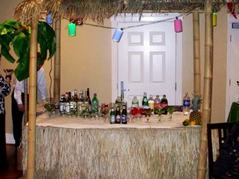 Tiki Hut: includestable, measures 8' high and 7' wide. Includes string lights.