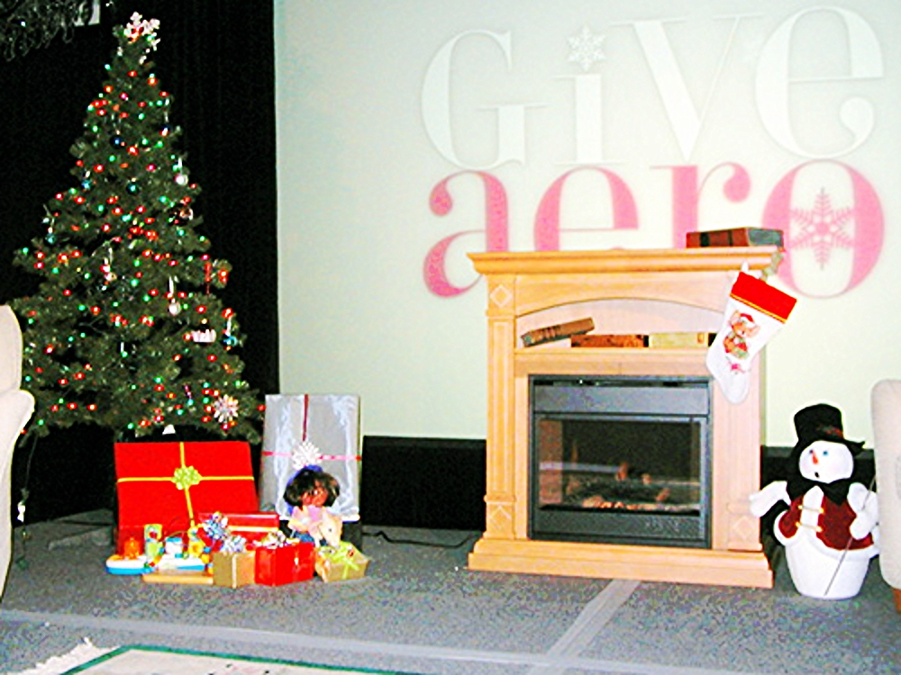 Fireplace Set with tree: Real electric fireplace with heat and faux flame. Add some other props for a nice cozy winter set.
