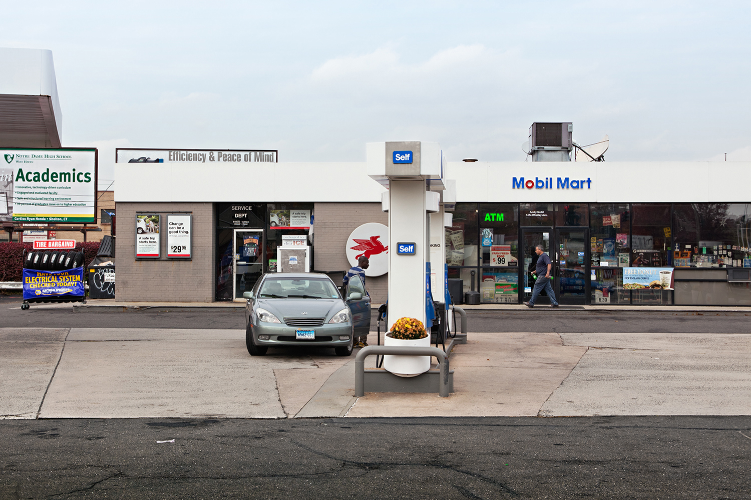 Mobil Mart. Amity Road, CT,  2010  Archival fiber inkjet print mounted to yellow sintra  32 x 48 inches