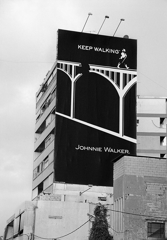 Johnnie Walker Post-War Advertisement.After 2006 Conflict. Beirut, Lebanon, 2006 - 2014  Archival Fiber Inkjet Print  10 x 15.5inches