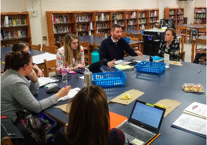 Calcutt's Principal Leadership Team examines data together
