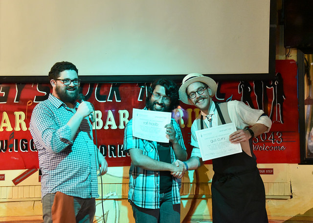 Rafi and Gus receive their certificates of achievement for first time public performance of their arrangements, presented by Jude, at Voices of Gotham's Tin Pan Alley Quartet Contest in March 2015.  Photo by  Steve Severinghaus .