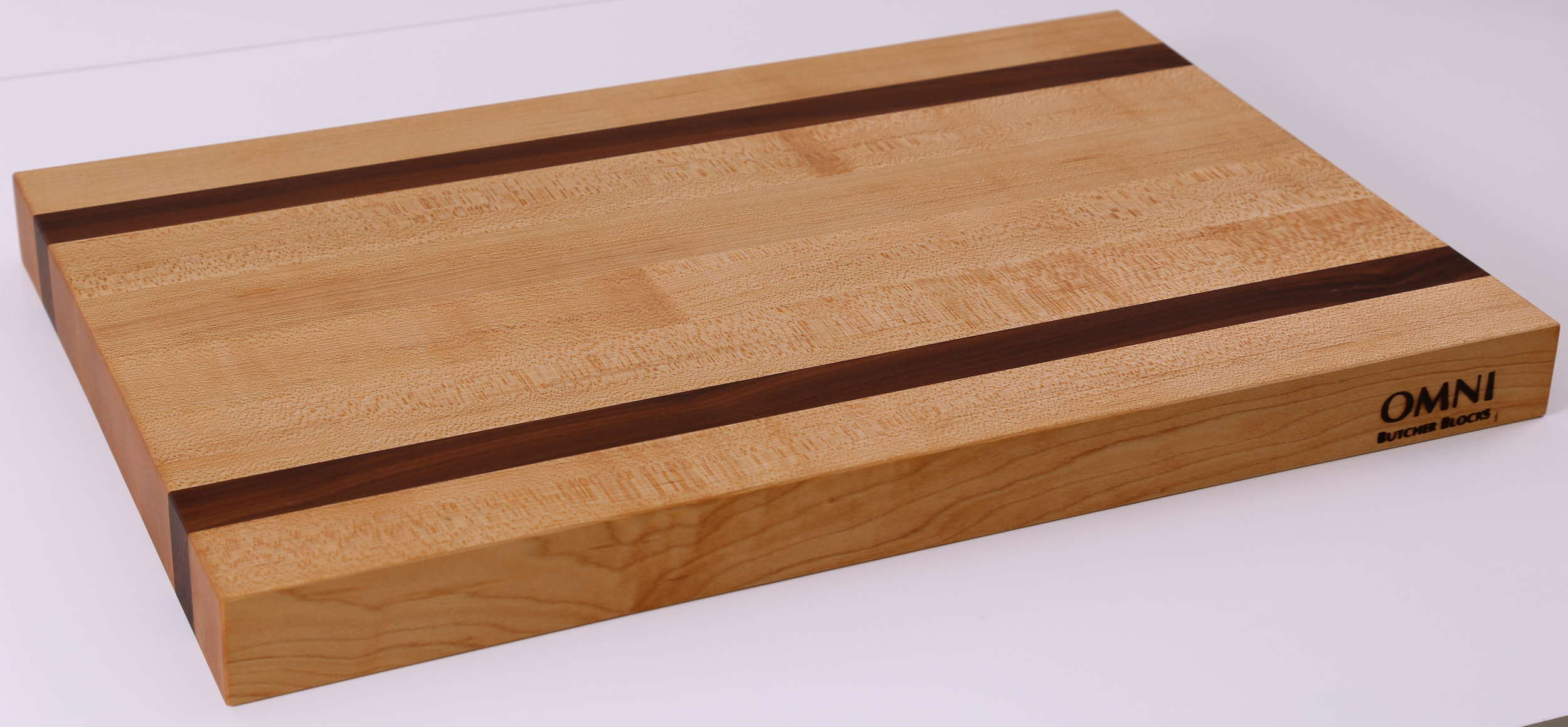 "Our best selling edge grain cutting board is now available in wholesale! This board is perfect for all kitchen sizes and the walnut inlay adds elegance to an everyday kitchen tool.  Approx. measurements are 18"" x 12"" x 1.5"""