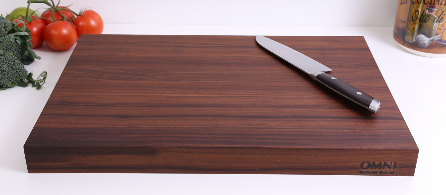 """This is a beautiful and practical board made of American Black Walnut. This attractive board doubles as a serving platter for bread, cheese and cured meats. This board is truly one of a kind!  Approximate measurements are 19"""" X 12"""" X 1.5"""".$119.00 plus applicable taxes and shipping."""