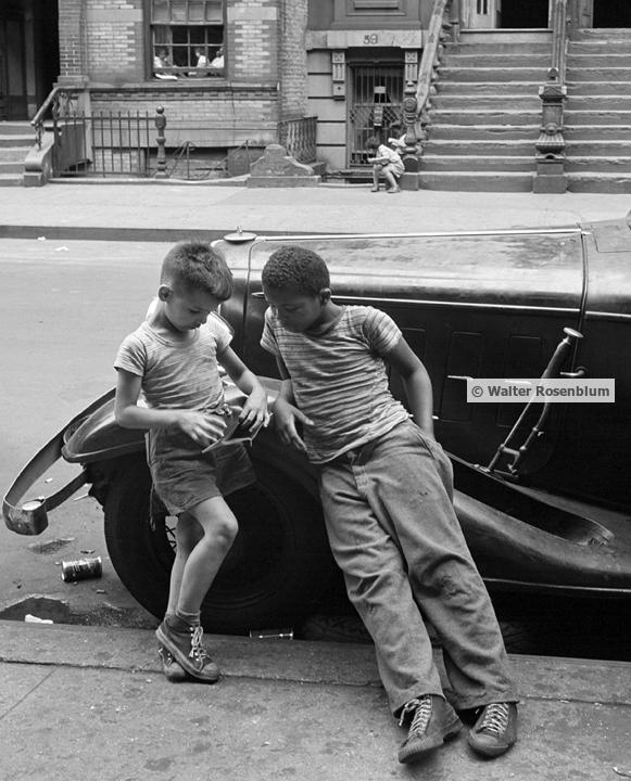 two boys leaning on car.jpg