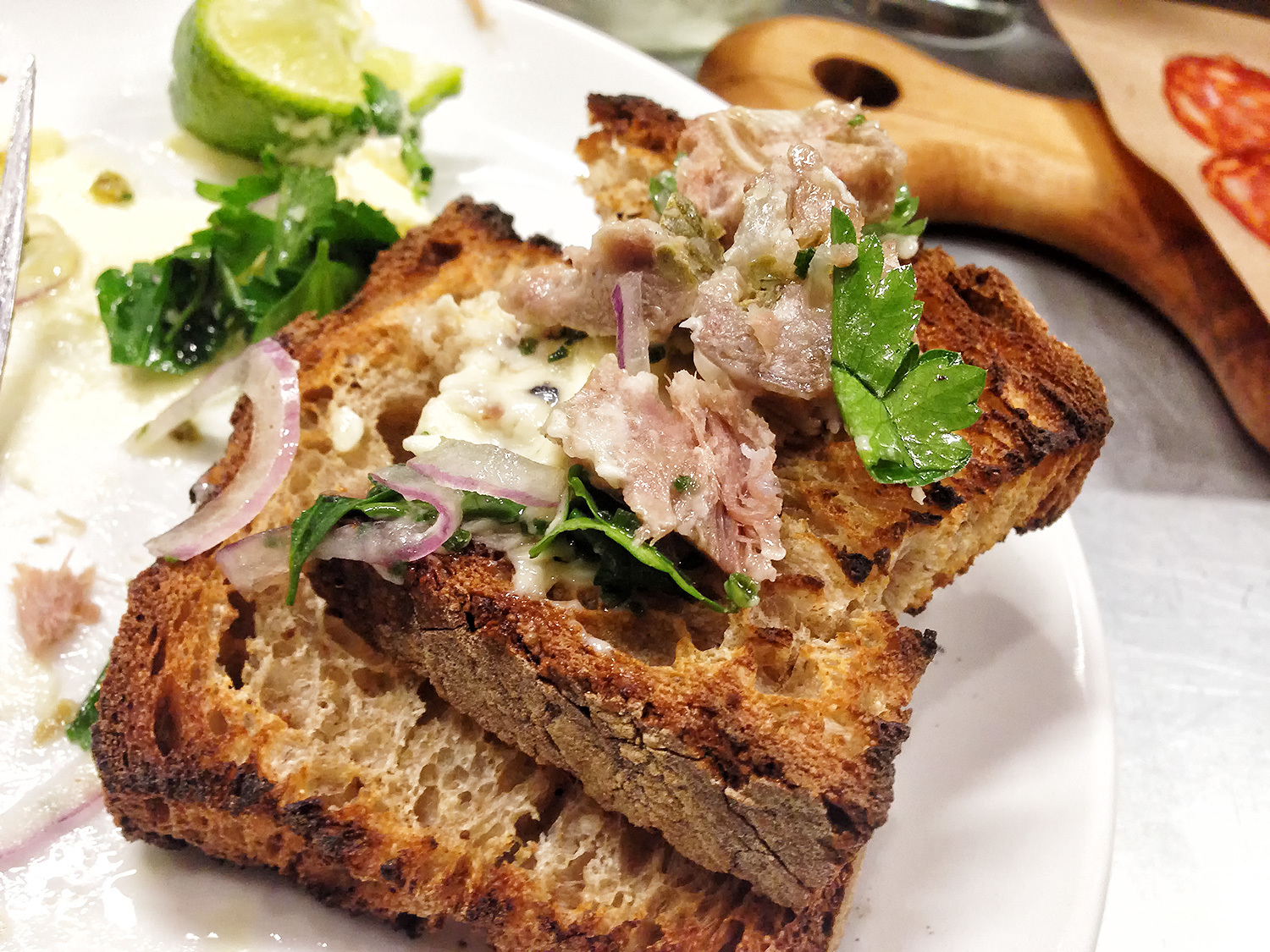 pig's head terrine with butter and toasted bread. (also lime, onions and parsley)