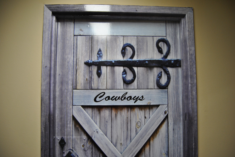 Close up Cowboy Restroom door wraps Rm wraps
