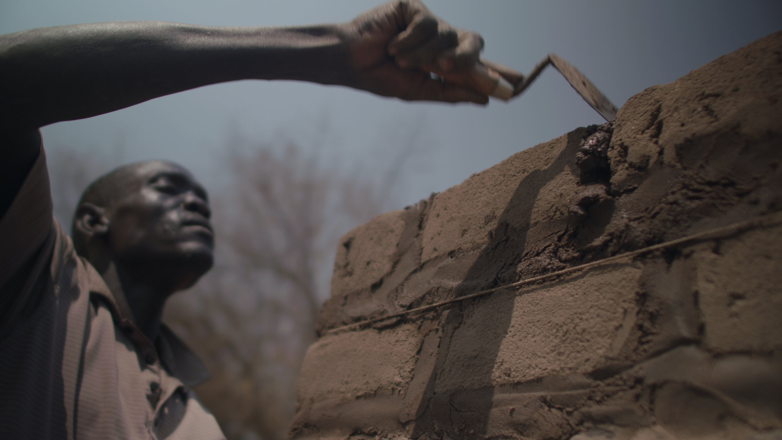 Bricklayers in Rhino Refugee Camp