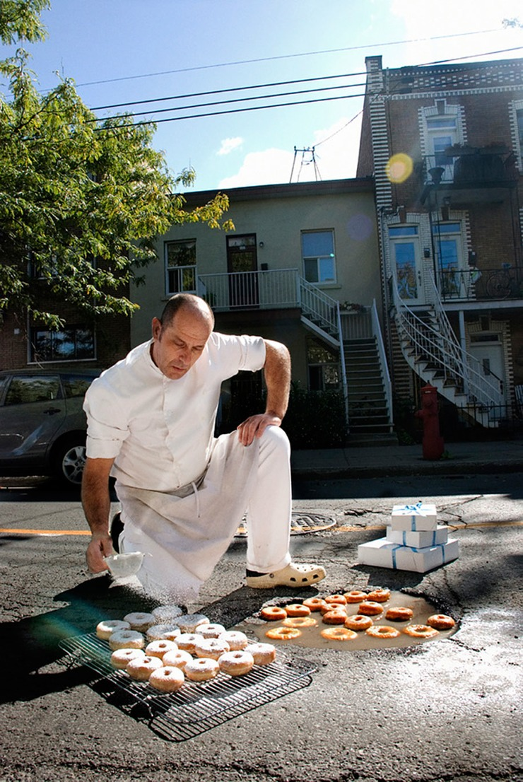 A man dressed as a chef adds sugar to donuts pulled from a pothole.