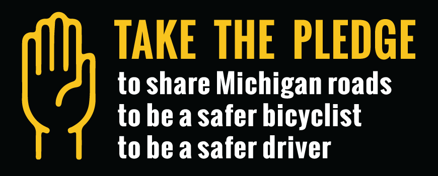Banner with a large hand icon with text saying 'Take the Pledge to share Michigan roads, to be a safer bicyclist, to be a safer driver'.