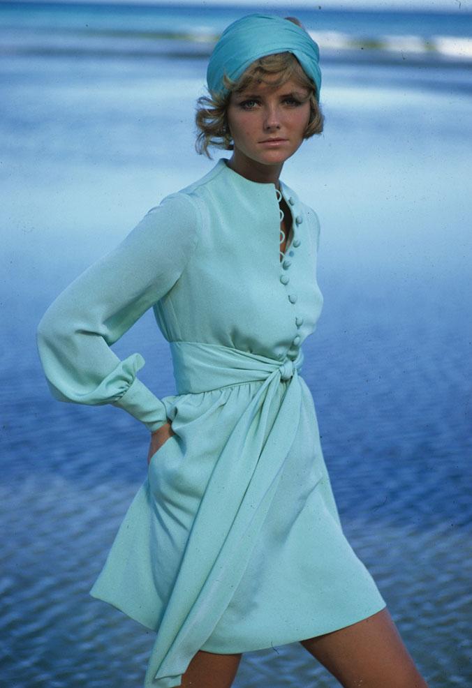 Cheryl Tiegs models a dress by Stan Herman in the 1960s.