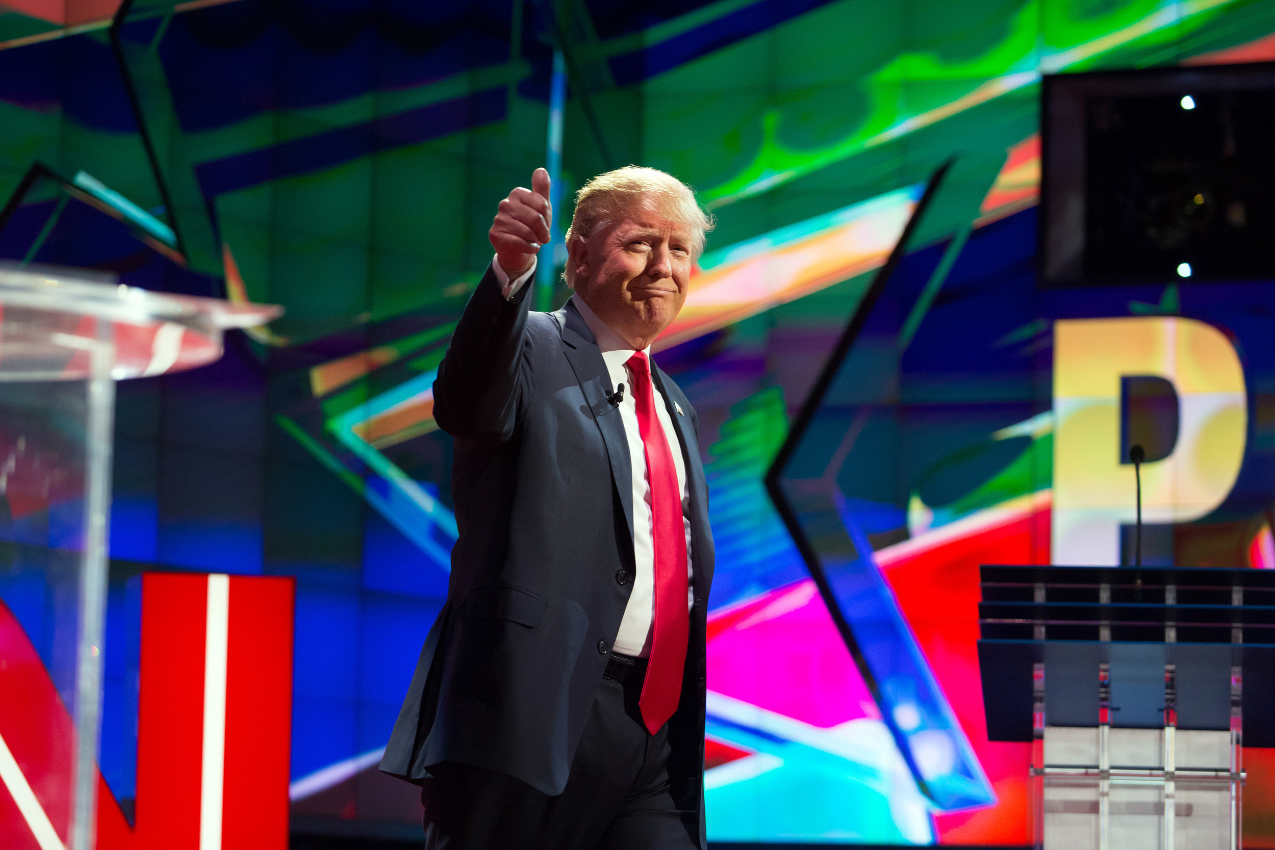 Donald Trump takes the stage at a GOP debate in Las Vegas during the presidential primary.