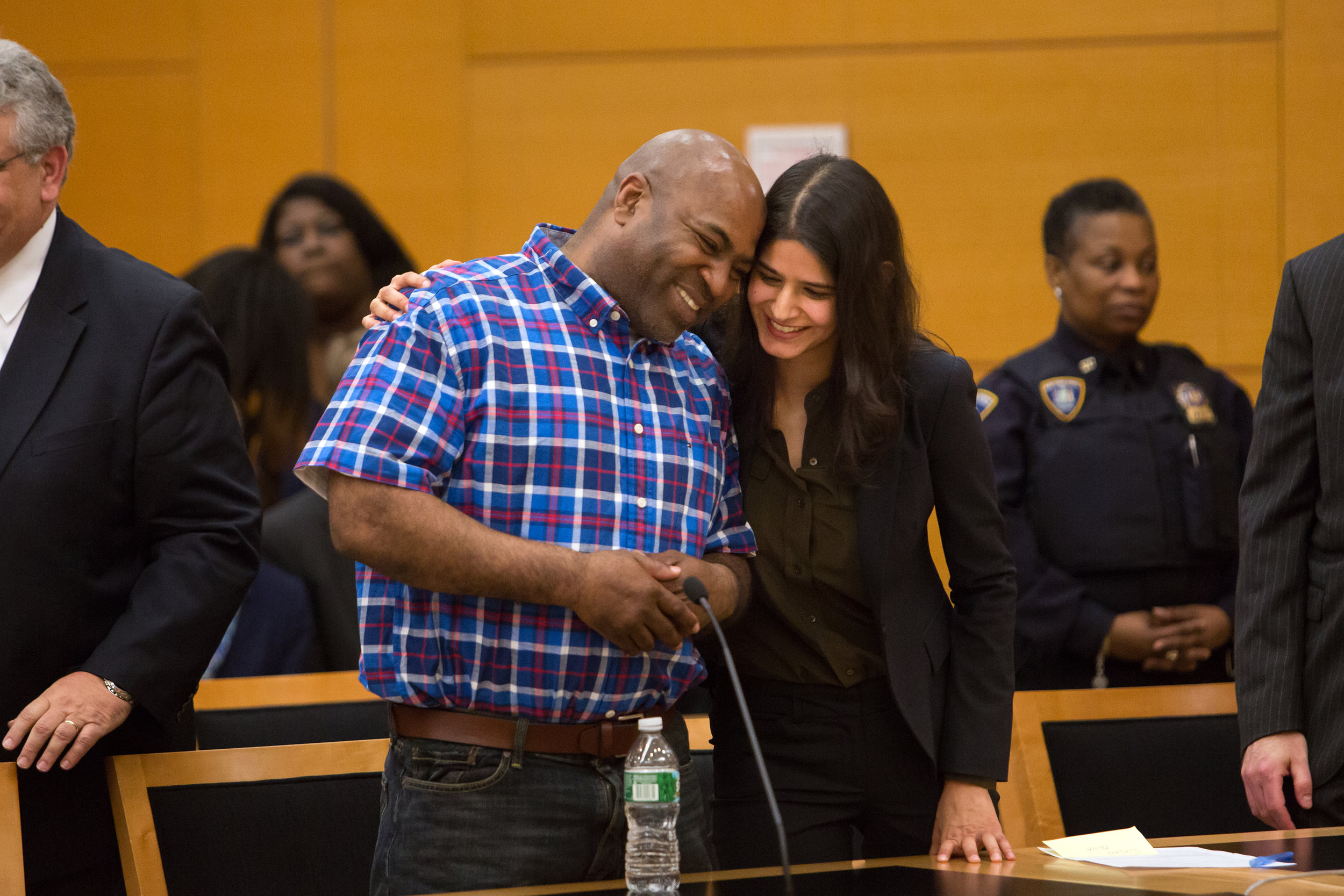 Andre Hatchett, a man who has been in state prison for more than two decades for a 1991 murder receives a hug from his attorney, Seema Saifze from the Innocence Project, in a Brooklyn court room after a judge overturned his conviction.