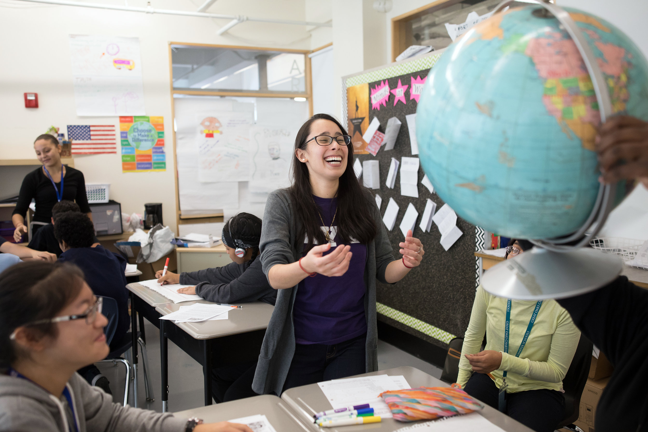 New York University student Adriana Garcia assisting students at Great Oaks, a charter school in the Lower East Side. Ms. Garcia is interning at the school as part of a teacher prep program that allows students to gain experience in the classroom while studying for their masters in education.