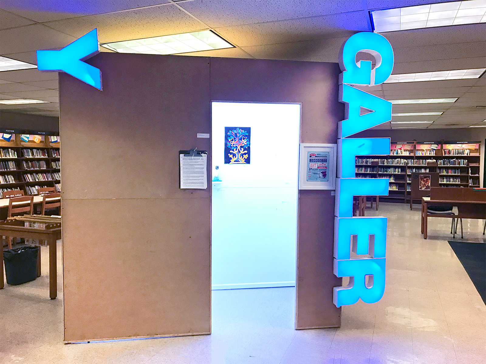 GALLERY 3  ( A Few Gems in the Crown  fundraiser for Brooklyn Public Library Crown Heights branch); MDO plywood, metal studs, channel letter sign, LED lights; 4'W x 8'L x 8'H; 2018.