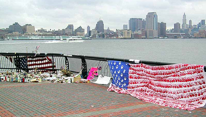 The makeshift 9/11 memorial on Pier A facing where the towers were. The Georgia handprint flag is on the right.