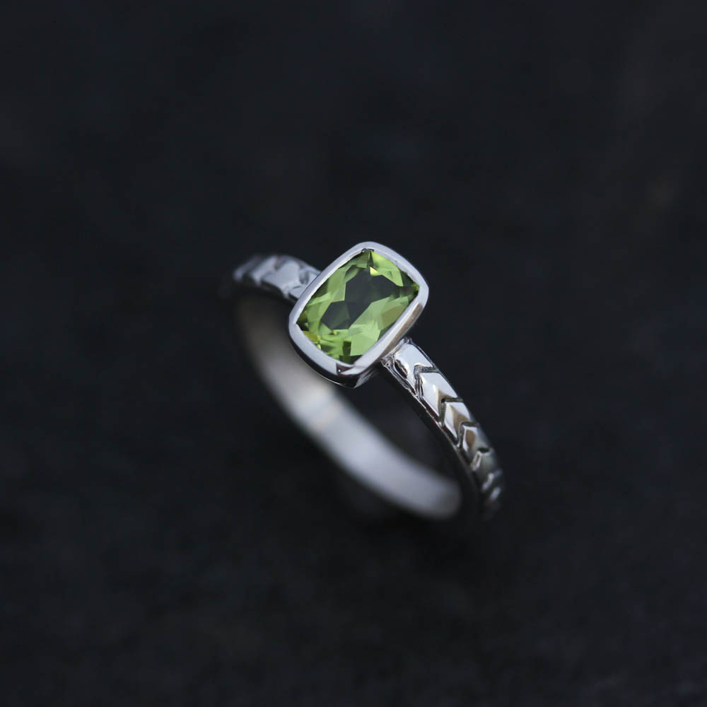 Featured is one of our most recent designs - Sterling Silver and Peridot with our unique hand carved Chevron band. Available for purchase  here.