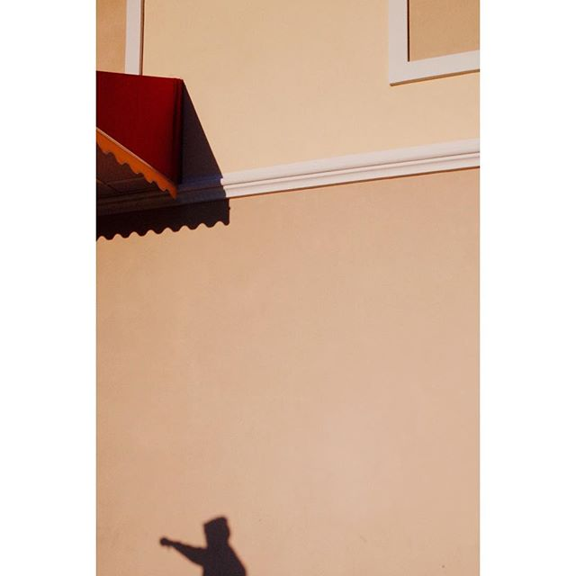 a storefront, a shadow