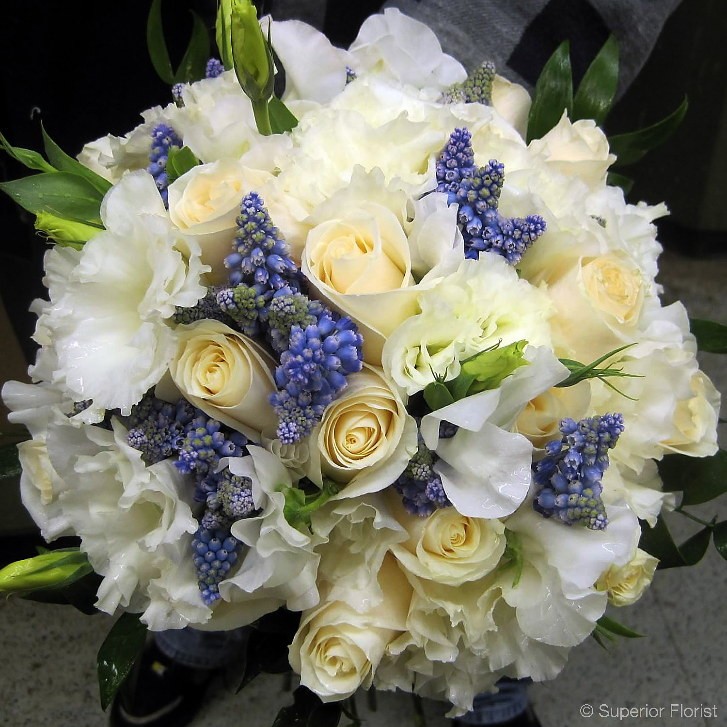 Superior Florist – Weddings – Personal Flowers: Hand tied bouquet of vendela roses, white Lisianthus and grape Hyacinth.