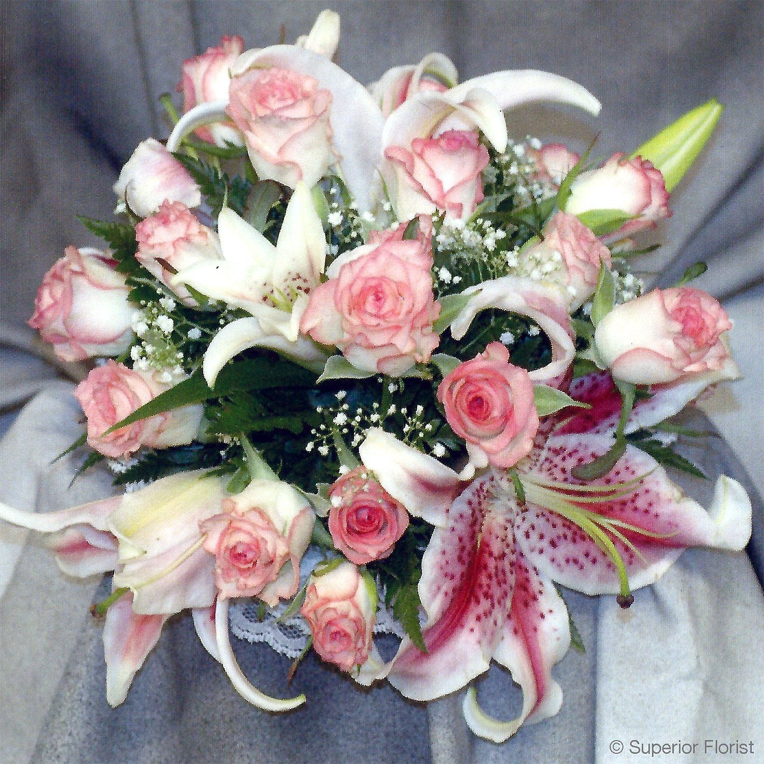 Superior Florist – Weddings – Personal Flowers: Hand tied bouquet of stargazer Lilies and two-toned roses of white and pink.