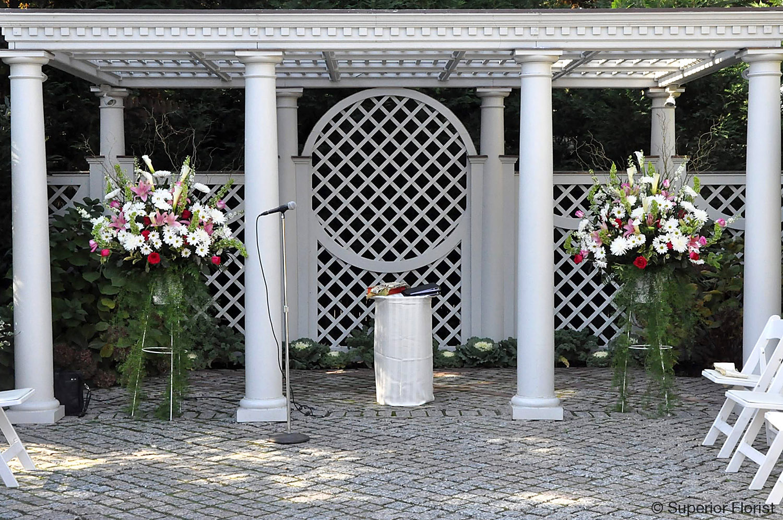Superior Florist – Wedding Ceremony: Spring wedding ceremony outdoors. Matching floral baskets under gazebo at the New York Botanical Garden.