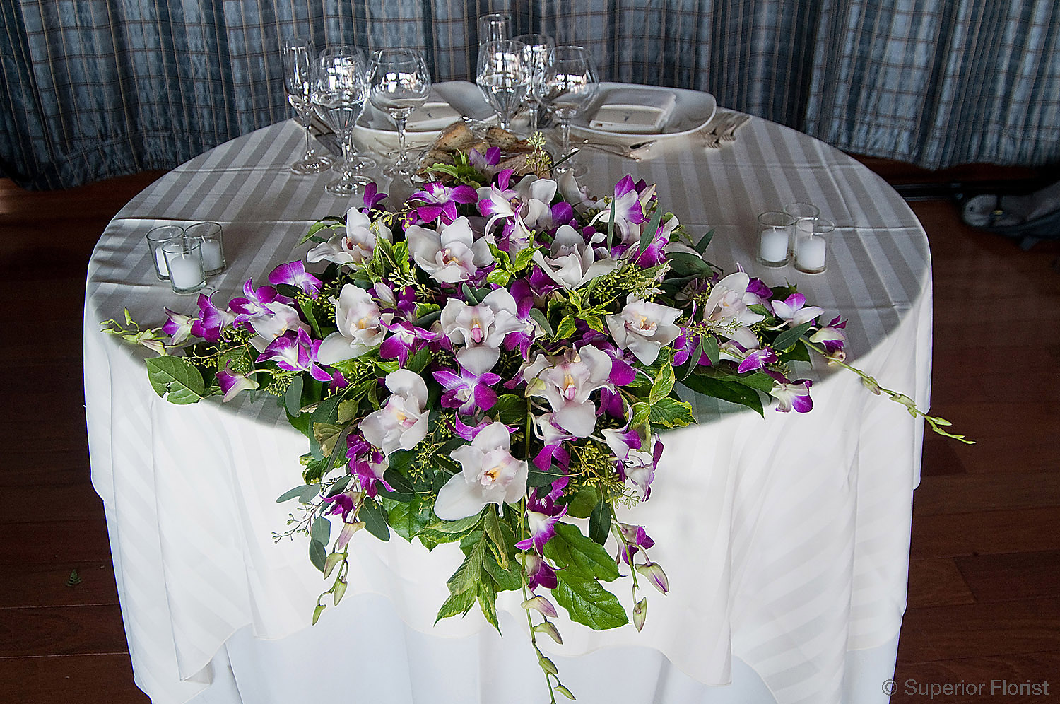 Superior Florist – Sweetheart Tables: Cascading Dendrobiums, Cymbidiums and foliage.