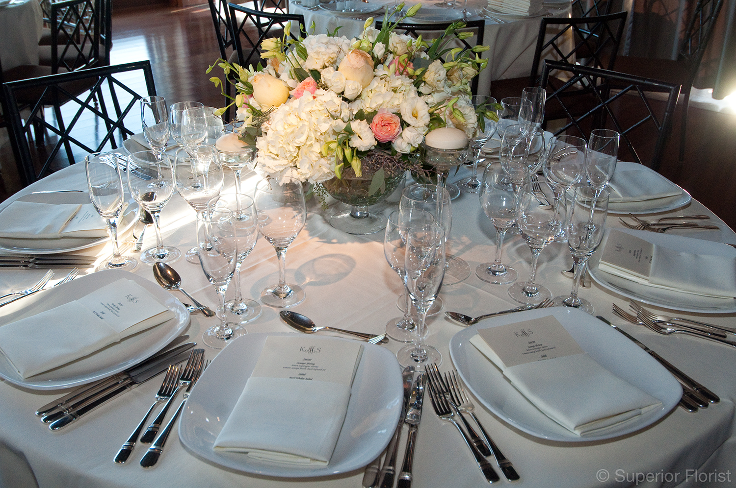 Superior Florist – Centerpieces:  Footed bowl of garden roses, Lisianthus and Hydrangeas.