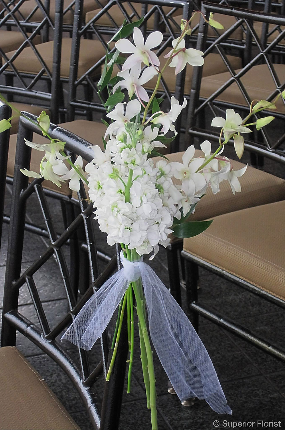 Superior Florist – Wedding Décor:  Aisle decoration of all white florals.