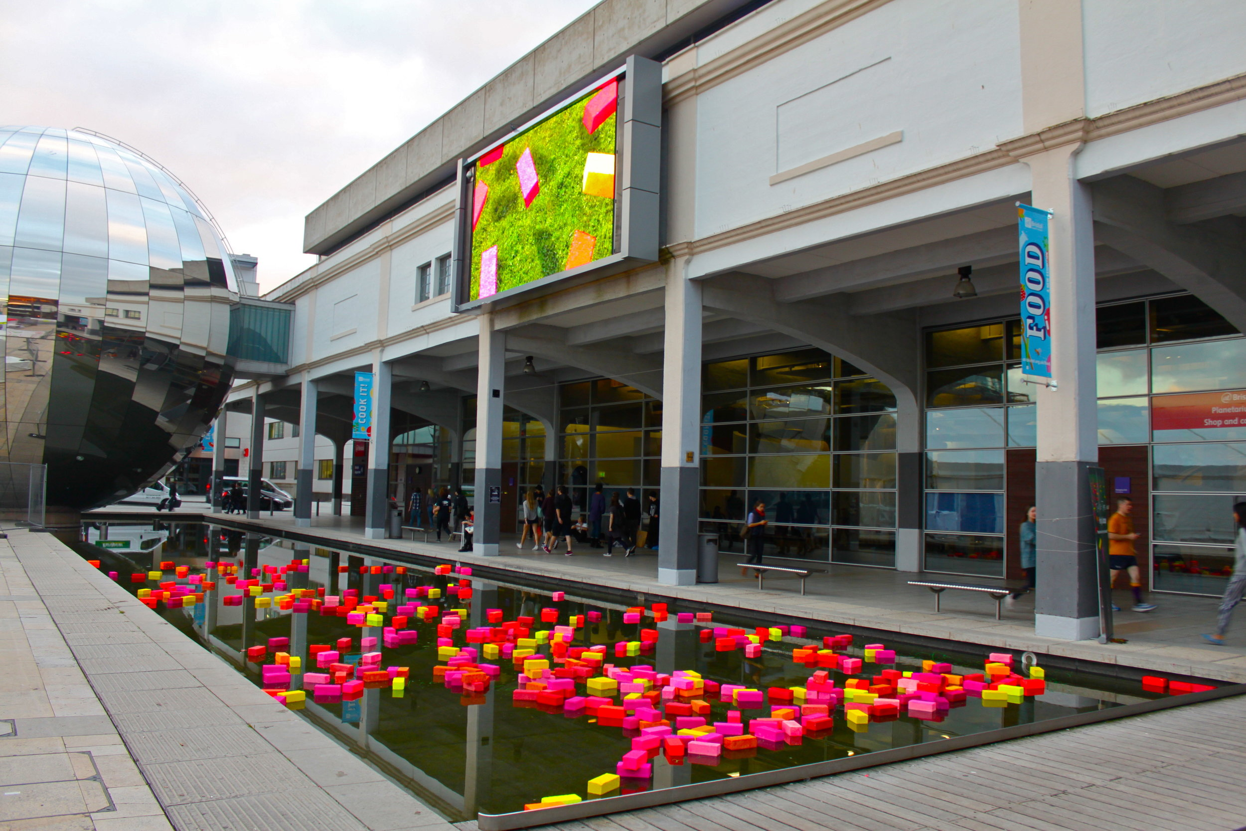 Ticker-Tape: Waterscape - Installation and PerformanceGovier collaborated with AHRC Power and the Water project team member Dr Jill Payne in the creation of a large-scale public art installation in the water spaces of Bristol's Millennium Square.The installation, Ticker-Tape: Waterscape, formed part of the Bristol Bright Night event hosted by the At-Bristol Science Centre and was designed to challenge viewers' perceptions of energy production in the landscape. A floating sculpture of 500 fluorescent bricks accompanied by a 5-minute visual soundscape broadcast on the BBC Big Screen overhead.Bristol Bright Night is part of the annual 'Researchers' Night' programme, an EU Commission-funded project that aims to engage publics across Europe in celebrating the latest and most stimulating research at a local and international level.AT-Bristol Science Centre.26.9.14.