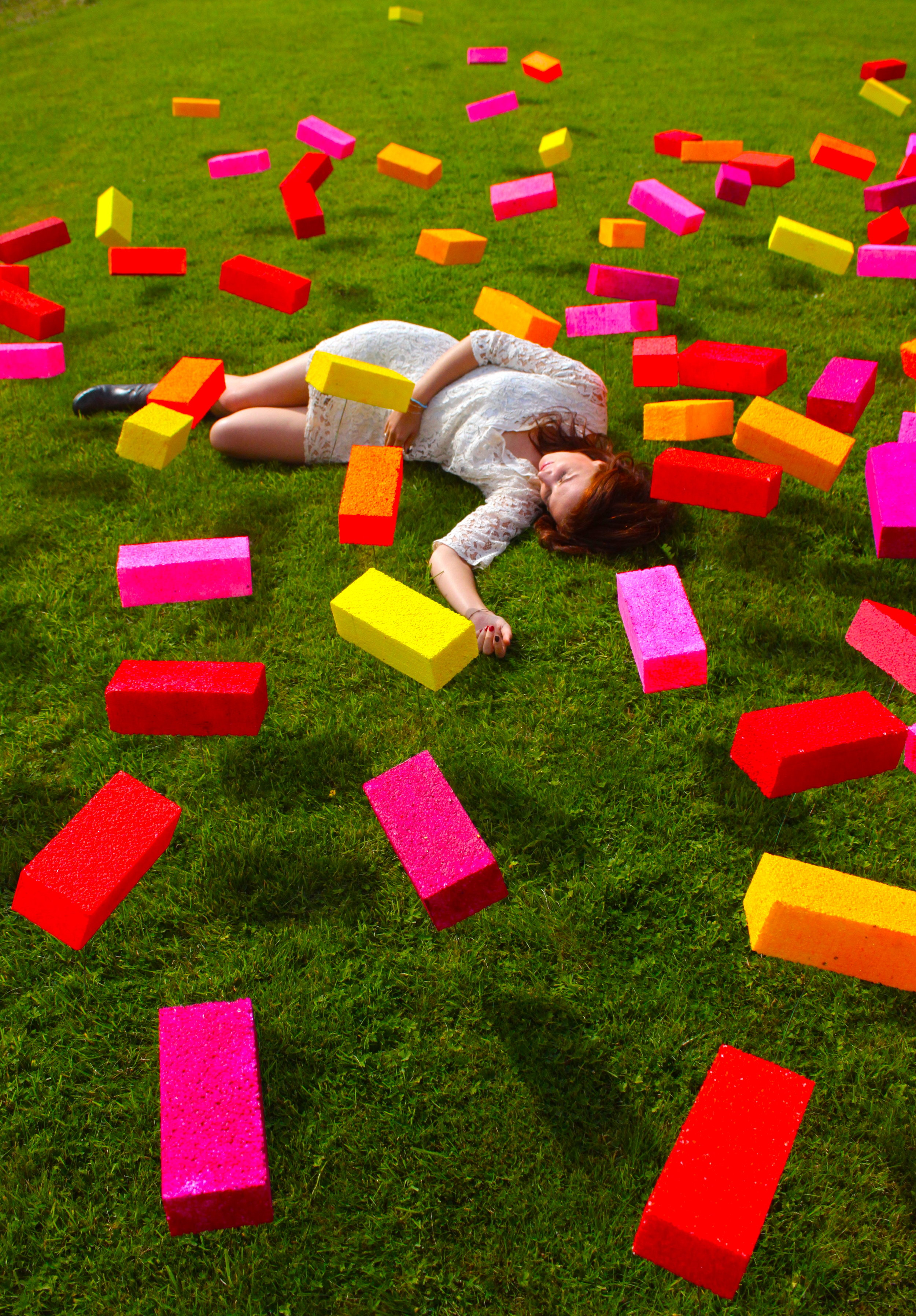 Ticker-Tape: Levitate - InstallationThe sculpture consisted of 150 levitating colourful bricks rising up above the border between England and Wales.From a far the bricks look like Ticker-Tape or confetti that has fallen, marking human presence.However, the bricks become tangible objects when viewed up-close, and by interacting with the environment (changing light, breeze) the piece creates tension within the overall landscape; referencing boundaries that are felt rather than seen.Cabalva Farm, Hereford Art Week.7.9.13-15.9.13.