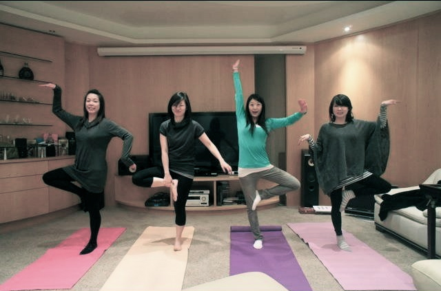having fun with tree pose - it's OK to giggle on your yoga mat