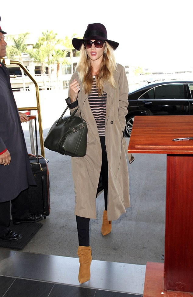 Balmain shoes, Givenchy bag, Eugenia Kim hat, Frame jeans, Brian Atwood shoes   Los Angeles International Airport, April 2014   Source