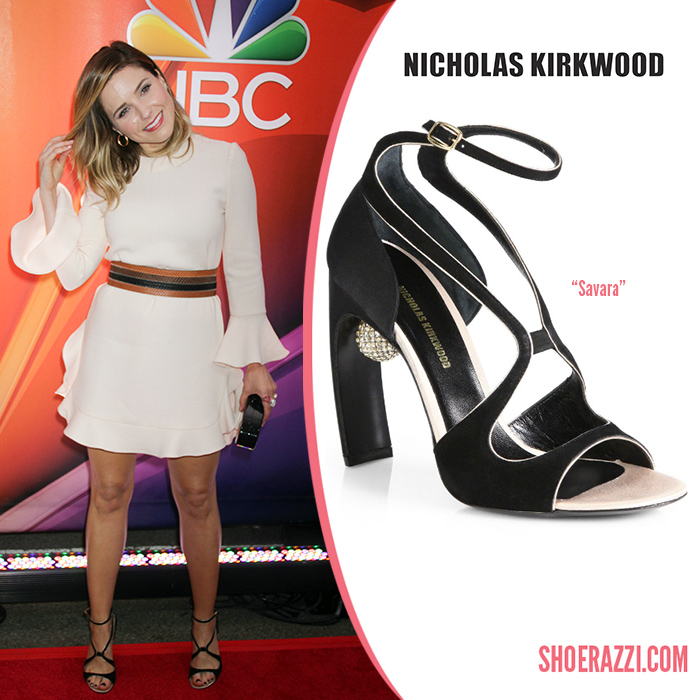 Credit: PR Photos   Sophia Bush  wore  Nicholas Kirkwood   Savara  sandals to the 2015 NBC Upfront Presentation at Radio City Music Hall in New York City. These heels are from the Spring 2014 collection featuring a black suede front & thin cross-straps, a black satin back, clear PVC straps and floating Swarovski crystal encrusted sphere attached to the heel breast. You can shop current styles at  Matches ,  Saks Fifth Avenue ,  Neiman Marcus  and  Nicholas Kirkwood .   Outfit Details : Jill Stuart Fall 2015 cream colored ruffled dress paired a multicolored snakeskin belt, a Edie Parker  Edie  clutch, a strawberry pink lip and several pieces of Karma Khali jewelry including the  Triology  ring in gold.