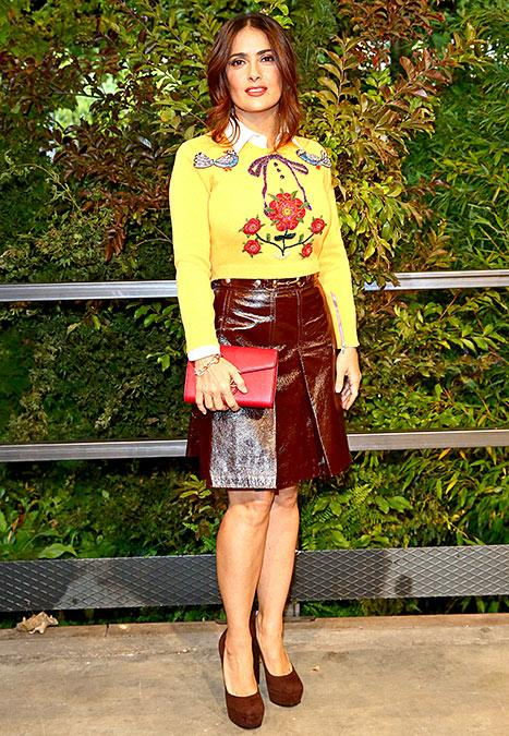 Who knew sweaters could be so hot?  Salma Hayek  simply stunned while attending the Gucci runway show during Milan Fashion Week on Thursday, Sept. 24. The star wore the perfect fall outfit while sitting front row, covered head to toe in the luxe brand, naturally.
