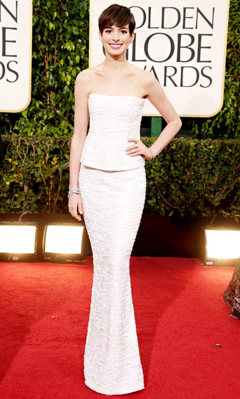 Credit: Jeff Vespa/WireImage.com   At the 2013 Golden Globes, Anne Hathaway donned the designer's beaded strapless dress from the SS09 haute couture collection.  Read more:  http://www.usmagazine.com/celebrity-style/pictures/hollywoods-hottest-fashion-designers-2013192/28606#ixzz3mlwtndSz