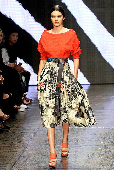 Credit: Bryan Bedder/Getty Images for Mercedes-Benz Fashion Week  Jenner rocked the runway in a bold red boatneck top and a full skirt with an eye-catching print for the Donna Karan show on Sept. 8, in New York.