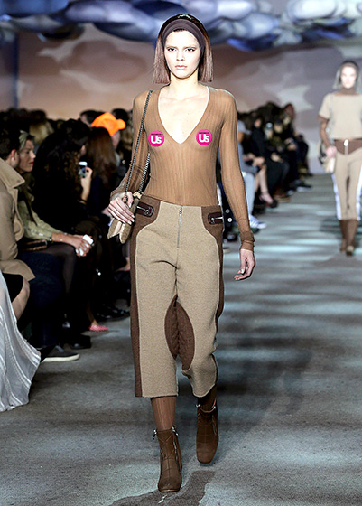 Credit: Neilson Barnard/Getty Images for Mercedes-Benz Fashion Week    The blossoming model made her highly anticipated debut for the Marc Jacobs during Mercedes-Benz New York Fashion Week on Feb. 14. Jenner looked out of this world, going braless in a plunging sheer top paired with brown riding pants.