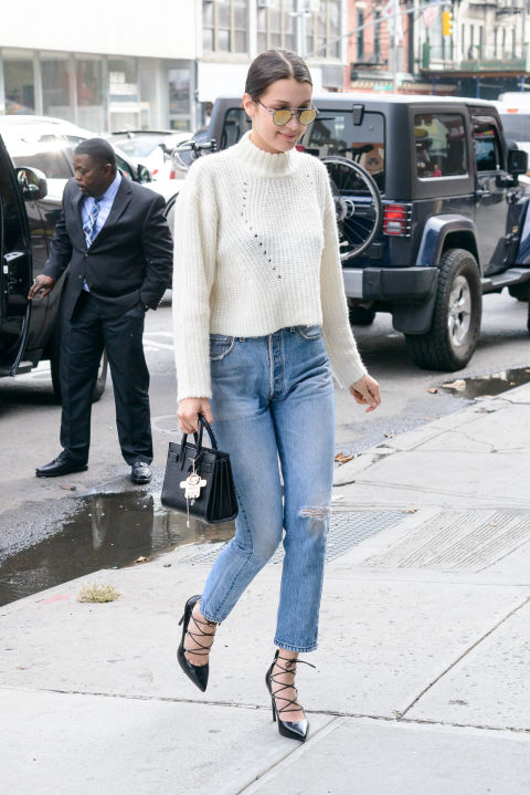 Who: Bella Hadid  When: October 9, 2015  Why: Bella Hadid dresses up your typical fall uniform of a sweater and jeans with on-trend lace-up heels and a ladylike bag.