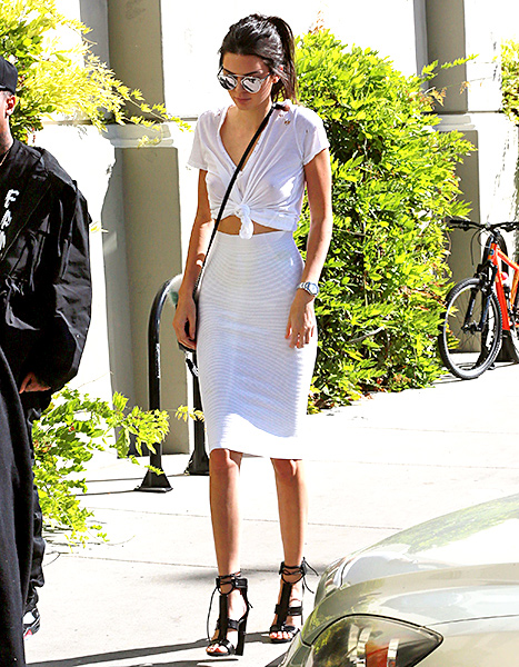 Kendall Jenner heads to Cinepolis Theater in Thousand Oaks, California on October 21, 2015 to celebrate pregnant reality star Kim Kardashian's birthday. Credit: WCP/4CRNS/VM/FAMEFLYNET PICTURES      Kendall Jenner took the rule-breaking look in a casual direction when she knotted a white tee into a crop top and paired it with a matching pencil skirt for her half-sister  Kim Kardashian 's birthday party on Oct. 21    Read more: http://www.usmagazine.com/celebrity-style/news/amal-alamuddin-reese-witherspoon-more-celebs-break-labor-day-rule-20152310#ixzz3ph0O4NZu  Follow us: @usweekly on Twitter | usweekly on Facebook