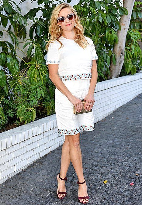 Reese Witherspoon attends CFDA/Vogue Fashion Fund Show and Tea at Chateau Marmont on October 20, 2015 in Los Angeles, California. Credit: Stefanie Keenan/Getty Images for CFDA/Vogue     Witherspoon, 39, rocked a two-piece Draper James ensemble in pure white with floral appliqués. She paired the outfit with perfect-for-fall marsala sandals, a textured gold box clutch, and floral earrings at the CFDA/Vogue Fashion Fund Show and Tea on Monday, Oct. 20.    Read more: http://www.usmagazine.com/celebrity-style/news/amal-alamuddin-reese-witherspoon-more-celebs-break-labor-day-rule-20152310#ixzz3ph1ktTD3  Follow us: @usweekly on Twitter | usweekly on Facebook