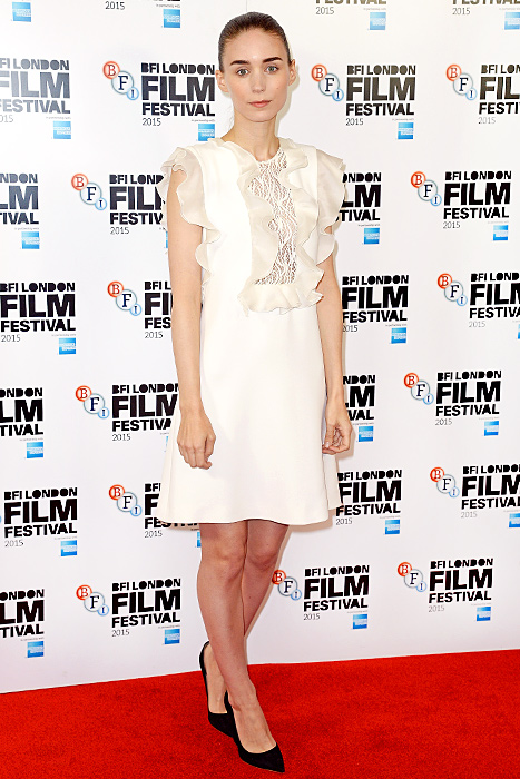 """Rooney Mara attends a photocall for """"Carol"""" during the BFI London Film Festival at Soho Hotel on October 14, 2015 in London, England. Credit: Dave J Hogan/Getty Images    Adding a bit of ruffled flair to a her  Carol photocall in London on Oct. 14, Rooney Mara wore a feminine frock in the colorless hue by Giambattista Valli with pointed black wedges for contrast.    Read more: http://www.usmagazine.com/celebrity-style/news/amal-alamuddin-reese-witherspoon-more-celebs-break-labor-day-rule-20152310#ixzz3phCAzzea  Follow us: @usweekly on Twitter 