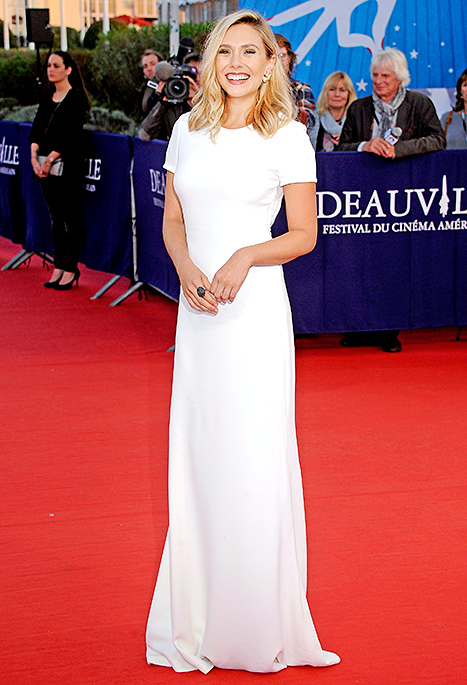 Elizabeth Olsen arrives at the 'Ruth And Alex' Premiere during the 41st Deauville American Film Festival on September 9, 2015 in Deauville, France. Credit: Francois G. Durand/WireImage.com    Proving that simple can be ultra glam, Elizabeth Olsen rocked this short-sleeved Calvin Klein collection gown with a cutout back. She let the minimalist dress shine, opting to accessorize only with statement-making gold leaf-motif Joan Hornig earrings.    Read more: http://www.usmagazine.com/celebrity-style/news/amal-alamuddin-reese-witherspoon-more-celebs-break-labor-day-rule-20152310#ixzz3phFTLeX4  Follow us: @usweekly on Twitter | usweekly on Facebook