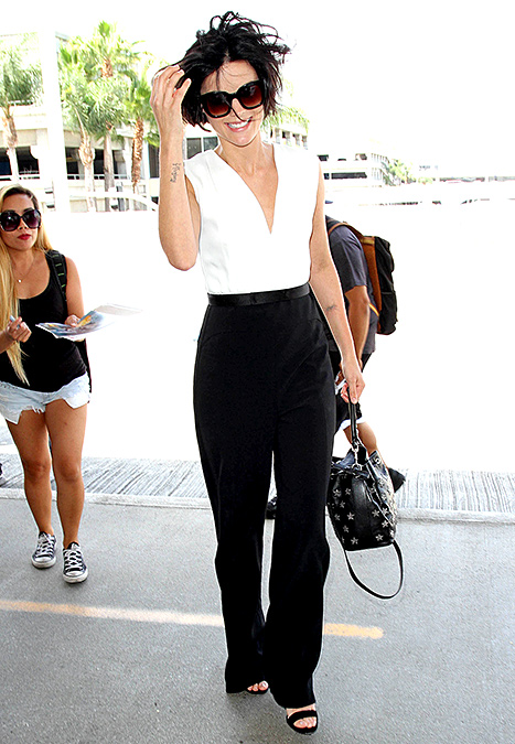 Jaimie Alexander is seen at LAX on August 13, 2015 in Los Angeles, California.  Credit: GVK/Bauer-Griffin/GC Images   Jaimie Alexander  headed out to promote her new series, NBC's  Blindspot , while wearing a plunging suit on Aug. 13 in Beverly Hills.  Read more:  http://www.usmagazine.com/celebrity-style/news/celebs-are-obsessed-with-black-and-white-jumpsuits-shop-the-trend-20152810#ixzz3qR9TC900   Follow us:  @usweekly on Twitter  |  usweekly on Facebook
