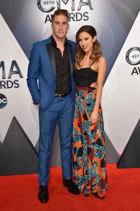 Shawn Booth and Kaitlyn Bristowe in a blue suit and color block and printed maxi dress.   The most recent couple to result from The Bachelorette wore mismatched looks on the CMAs red carpet. Booth sported a bright blue suit with a black shirt, while his fiancee Kaitlyn had on a rather casual maxi dress with a black top and printed skirt. These two don't seem to have yet mastered the fine art of couple's dressing!