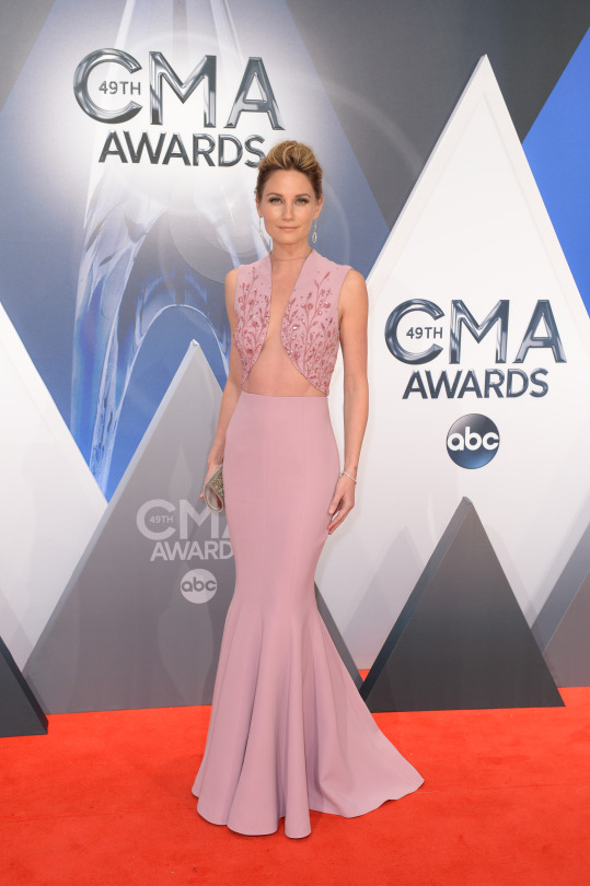Jennifer Nettles in a dusty pink gown with beading and illusion panels.   The Sugarland singer stood out from the rest in a perfectly tailored, dusty pink gown. The top is covered in beaded embroidery, which shimmered when the light hit it. Though the dress's neckline appears to be fairly scandalous, everything was held in place with the help of an illusion panel extending from the waist up