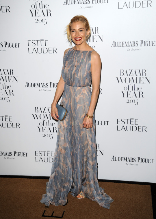 Sienna Miller was practically the only star who didn't wear black or white or a mixture of both, but we love her Valentino dress regardless.   [Photo: Rex]