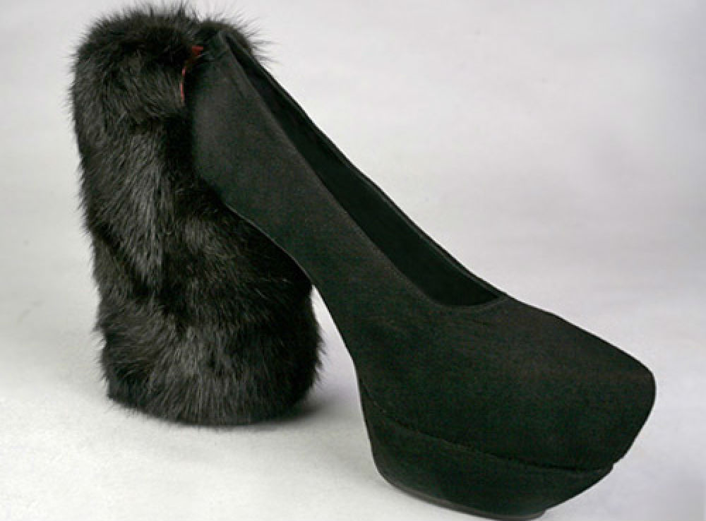2. This furry monstrosity brings the concept of a chunky heel to a whole other level. We have a feeling that one of the Kardashians would probably wear them.